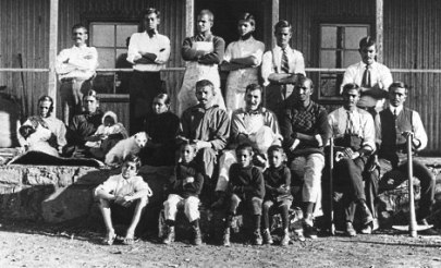 15a-Gandhi (seated center row, 5th from right) with members of his Tolstoy Farm in South Africa, 1910