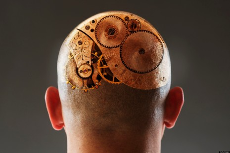 Back view of man with gears in shaved head